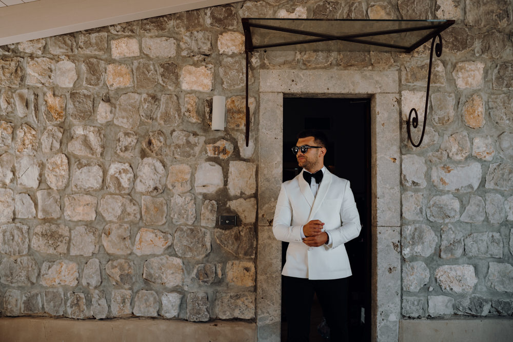 Groom Suit Bow Tie White Jacket Aquapetra Resort Spa Wedding Peter Hughes Photography
