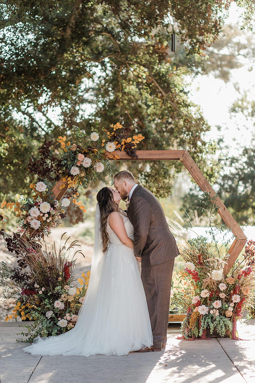 California Ranch Wedding WildflowerPhotoCo Flower Arch Backdrop Hexagon Flowers Ceremony Aisle