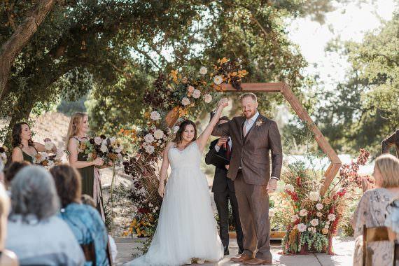 Flower Arch Backdrop Hexagon Flowers Ceremony Aisle California Ranch Wedding WildflowerPhotoCo