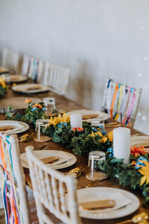 Rainbow Riboons Chairs Decor Long Tables Candles Greenery Foliage Chypraze Wedding Barn Clara Cooper Photography