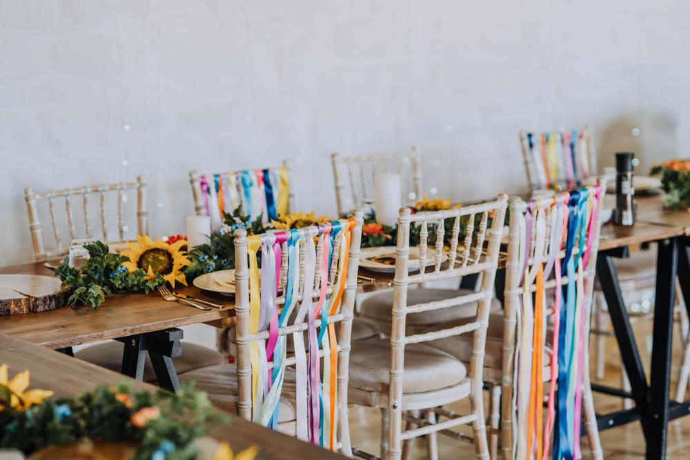 Rainbow Riboons Chairs Decor Chypraze Wedding Barn Clara Cooper Photography