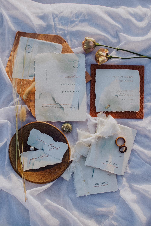 Stationery Suite Flat Lay Invite Invitation Rust Camel Callgraphy Coastal Elopement Manon Pauffin Photography
