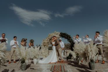 Crete Destination Wedding Me and Georgia Photography Aisle Ceremony Moon Gate Flower Arch Rugs Pampas Grass Backdrop