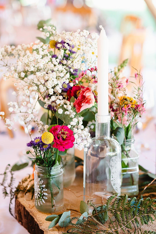 Centrepiece Log Slice Jar Flowers Colourful Wild Candle DIY Tipi Wedding Fiona Kelly Photography