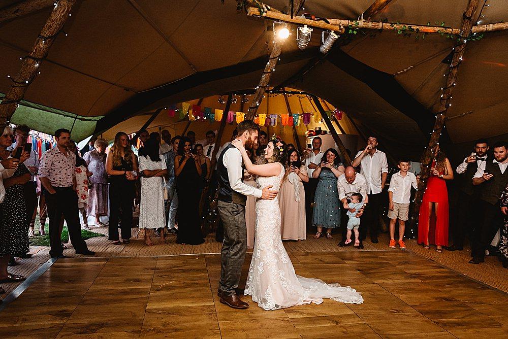 Arch Colourful Rainbow Multicolour Entrance Pom Poms Ribbons Pinwheels DIY Tipi Wedding Fiona Kelly Photography
