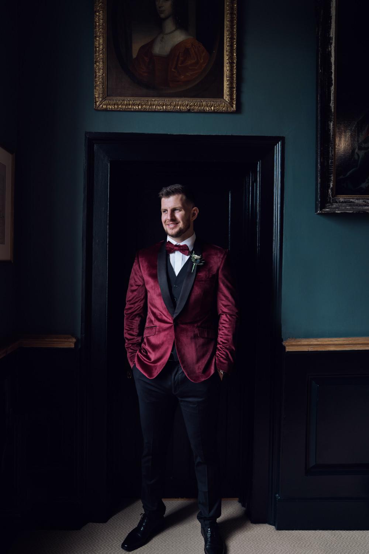 Groom Suit Red Velvet Bow Tie Decadent Christmas Wedding Jessica Raphael Photography
