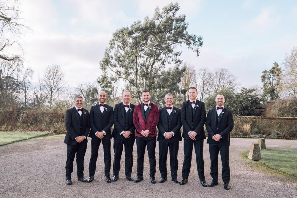 Groom Groomsmen Tuxedos Suits Bow Ties Decadent Christmas Wedding Jessica Raphael Photography