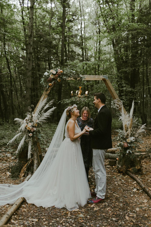 Dreamy Woodland Wedding Ideas Jasmine Andrews Photography Outdoor Ceremony Aisle Hexagon Backdrop Pampas Grass Greenery Foliage
