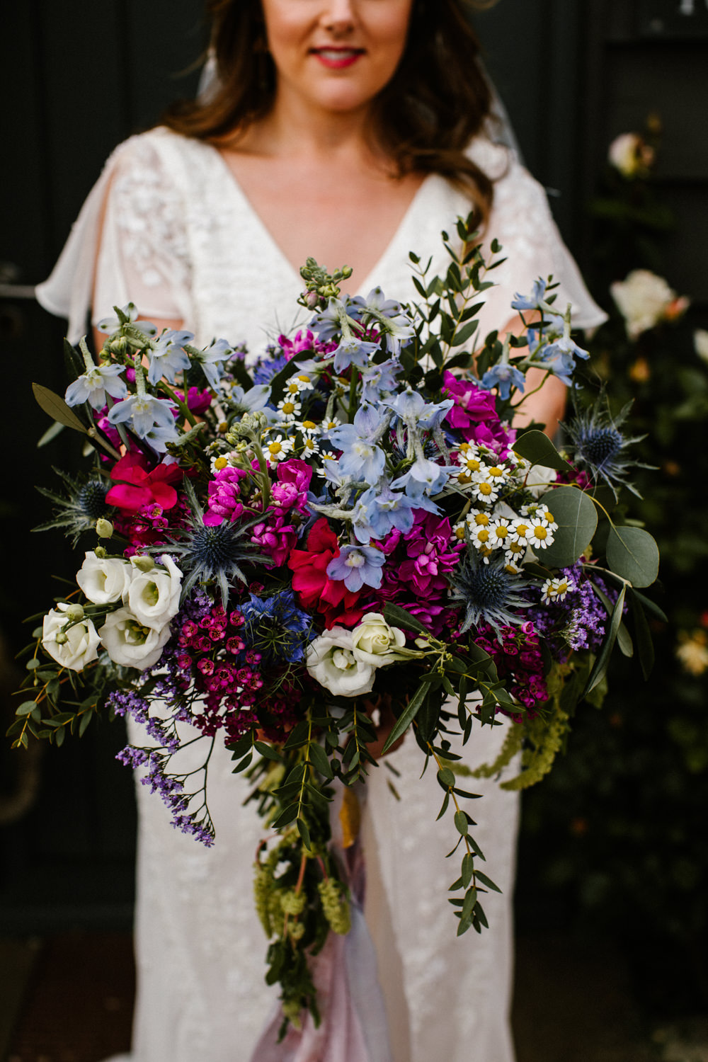 Bouquet Flowers Bride Bridal Lithianthus Daisy Thistle Wax Flower Pink Blue Titchwell Manor Wedding Honey and The Moon Photography