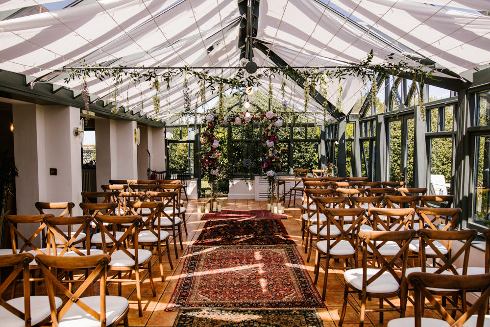 Hanging Flowers Suspended Florals Decor Conservatory Ceremony Aisle Rugs Titchwell Manor Wedding Honey and The Moon Photography