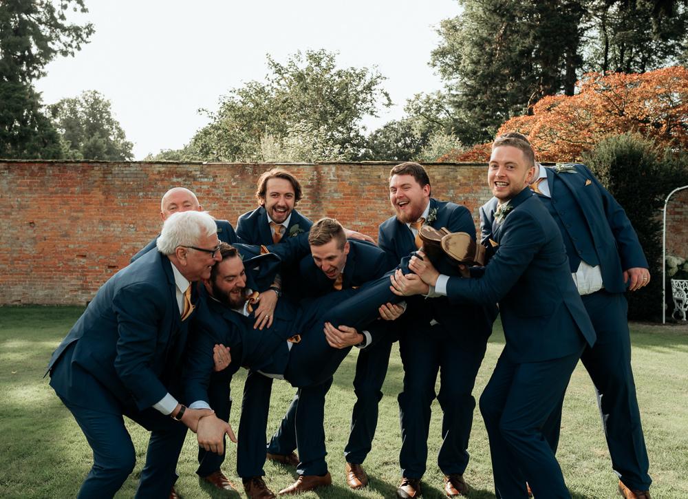 Groom Suit Navy Mustard Yellow Tie Pocket Square Groomsmen Combermere Abbey Wedding Damian Brandon Photography