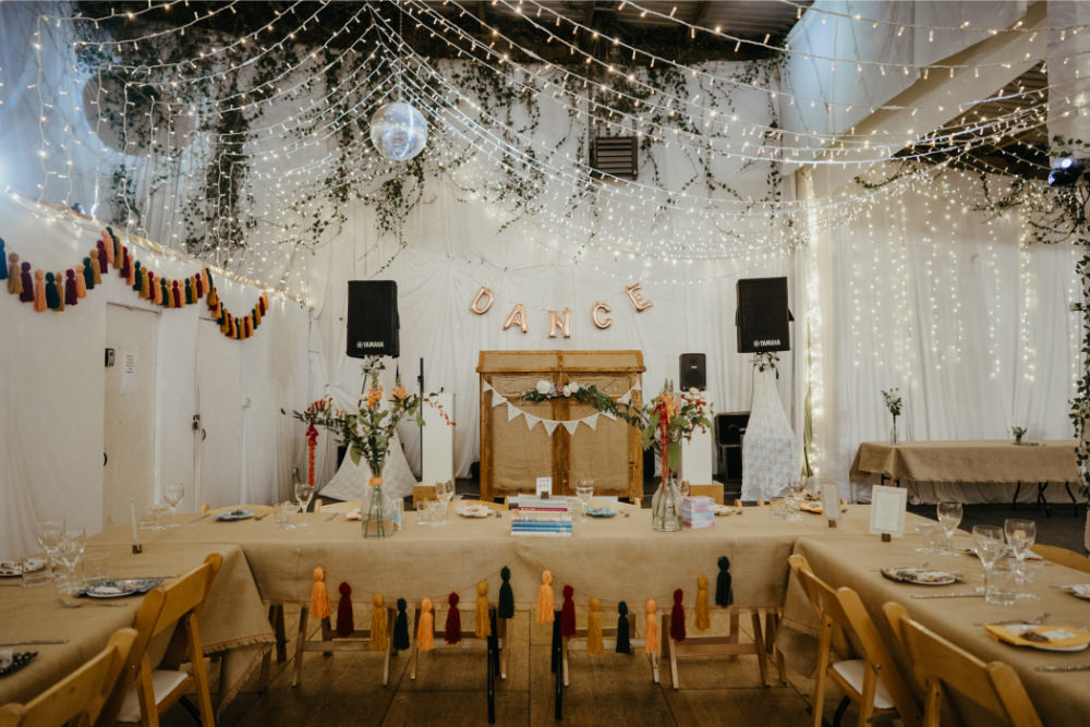 Barn Fairy Lights Lighting Canopy Long Tables Bunting Decor Hearts Literary Wedding Naomi Jane Photography