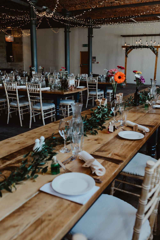 Table Decor Centrepiece Flowesr Bottle Flowers Arches Dean Clough Wedding Stevie Jay Photography