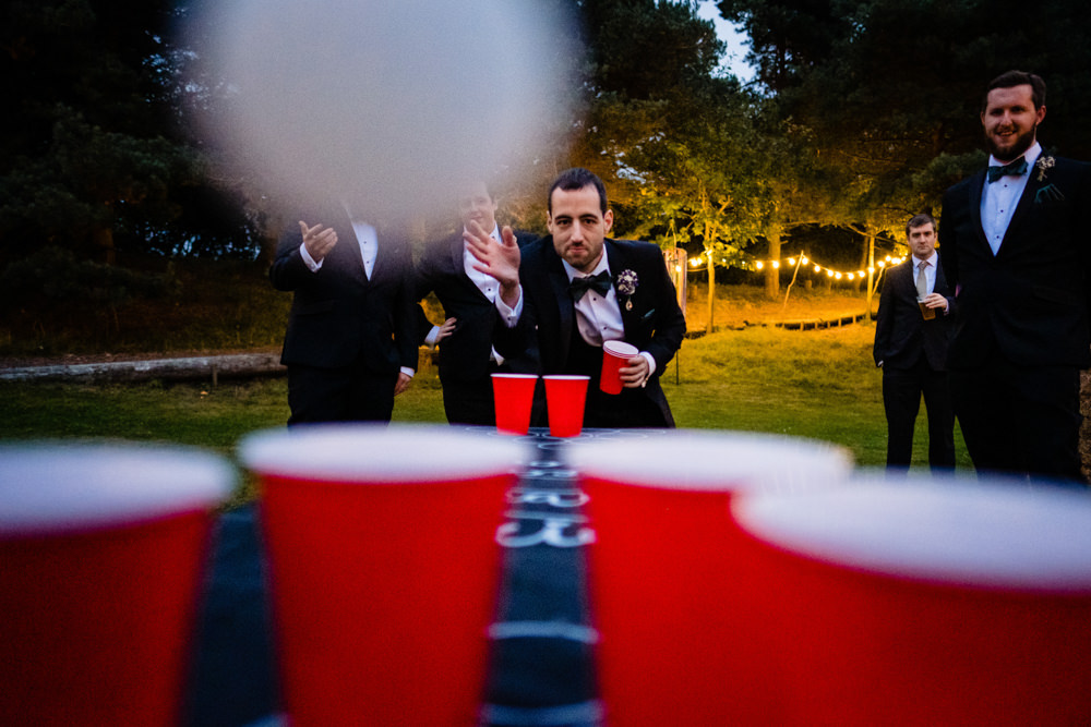 Beer Pong Game Cowshed Woodhall Farm Wedding Emma and Rich