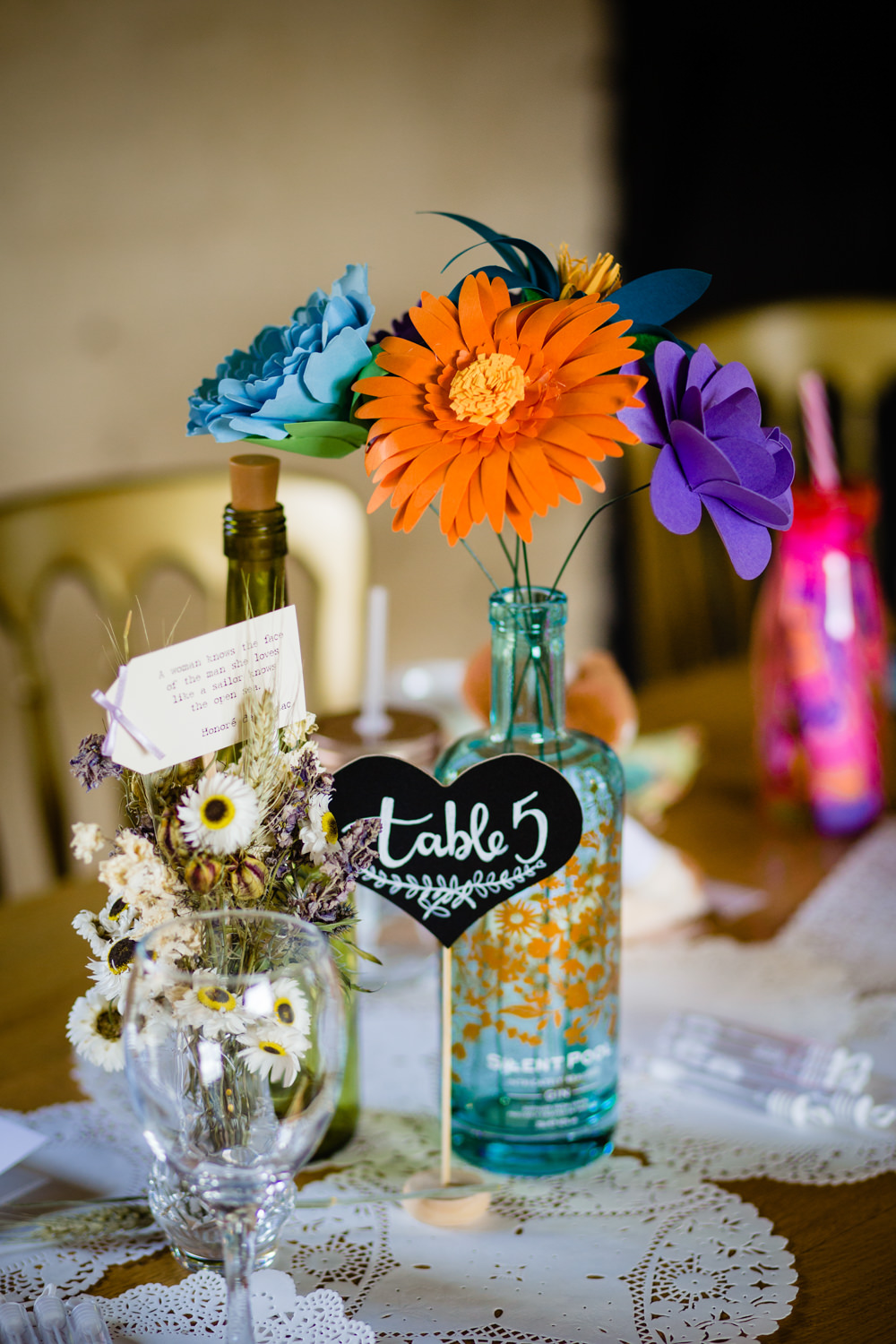 Centrepiece Decor Colorful Paper Flowers Bottles Table Number Cowshed Woodhall Farm Wedding Emma and Rich