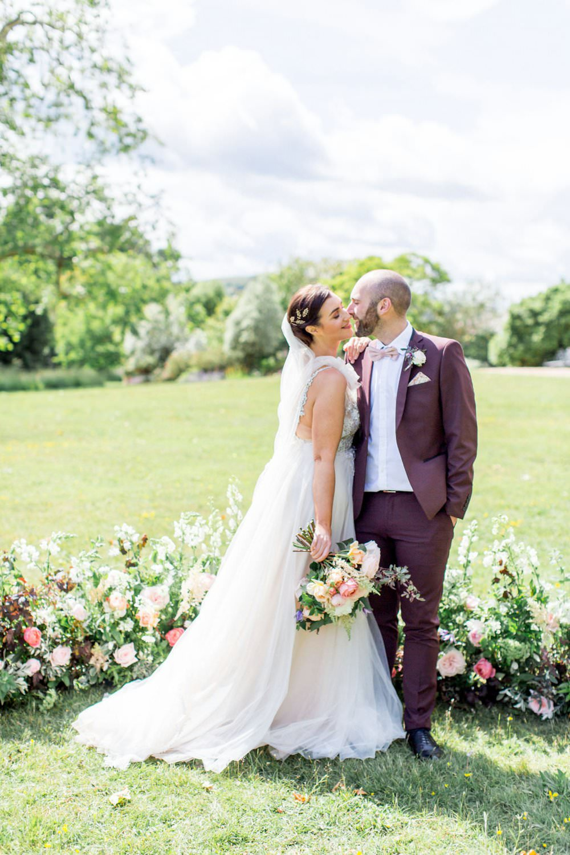 English Garden Wedding Inspiration Philippa Sian Photography Meadow Flowers Ceremony Backdrop Arrangement Dress Gown Bride Bridal Straps Tulle Veil