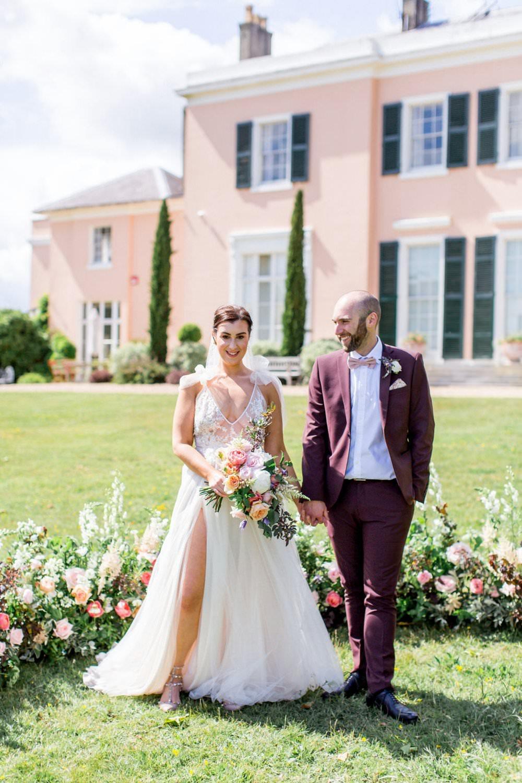English Garden Wedding Inspiration Philippa Sian Photography Meadow Flowers Ceremony Backdrop Arrangement Dress Gown Bride Bridal Straps Tulle Split Skirt