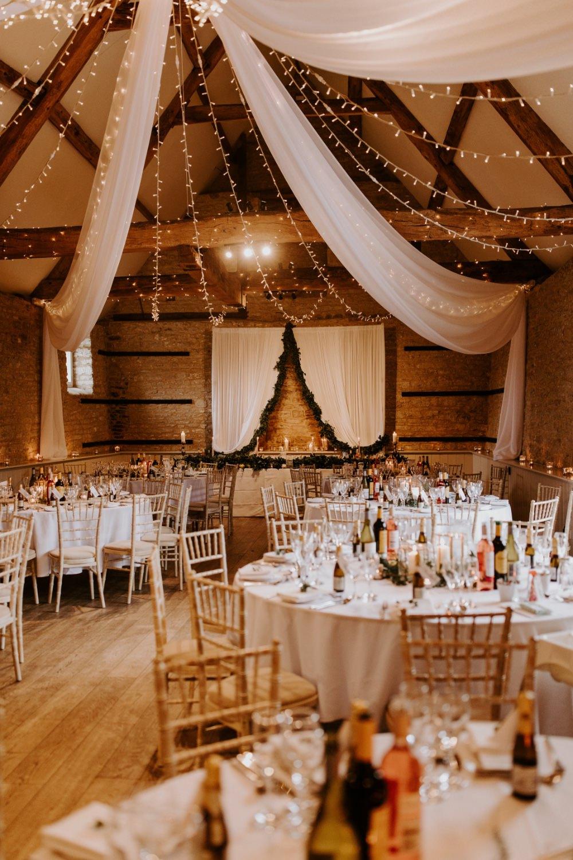 Barn Reception Venu Backdrop Drapes Fabric Greenery Fairy Lighs Lighting Canopy Wick Farm Bath Wedding Siobhan Beales Photography