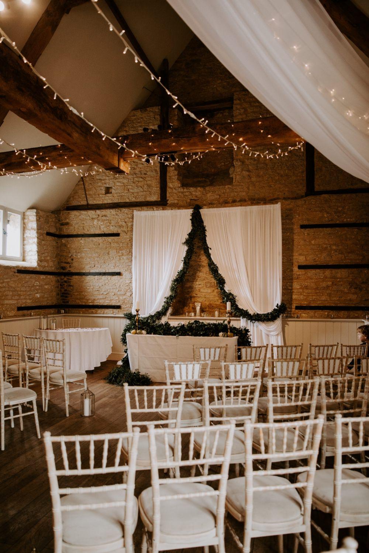 Barn Ceremony Backdrop Drapes Fabric Greenery Fairy Lighs Lighting Canopy Wick Farm Bath Wedding Siobhan Beales Photography