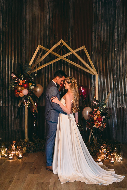 Balloon Wedding Ideas Leesha Williams Photography Geometric Backdrop Balloons Candles Ceremony Aisle