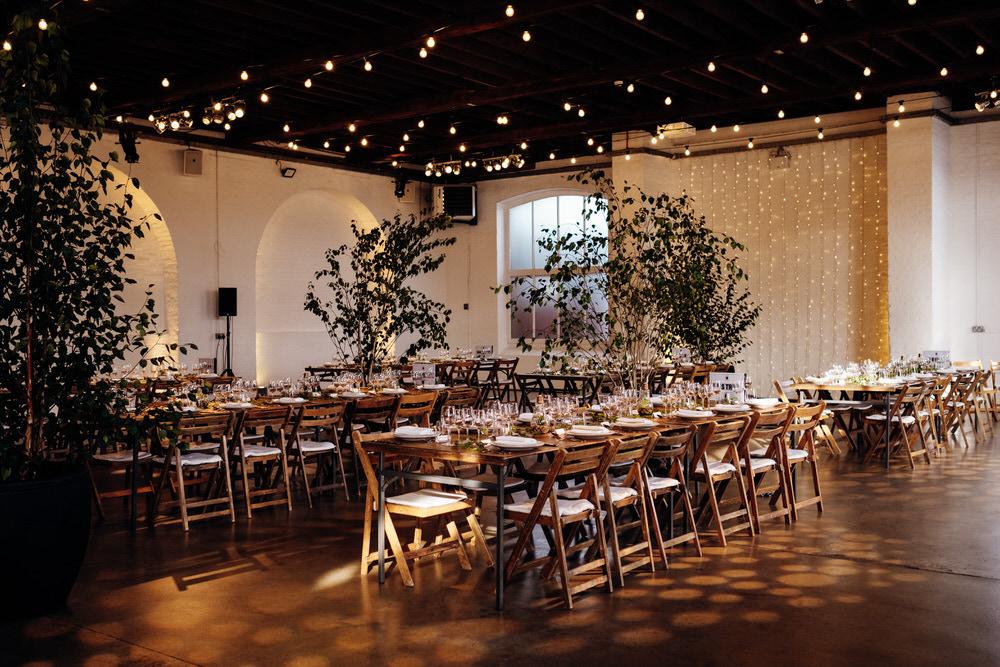 Warehouse Reception Industrial Trees Festoon Lights Chainstore Wedding Marianne Chua Photography