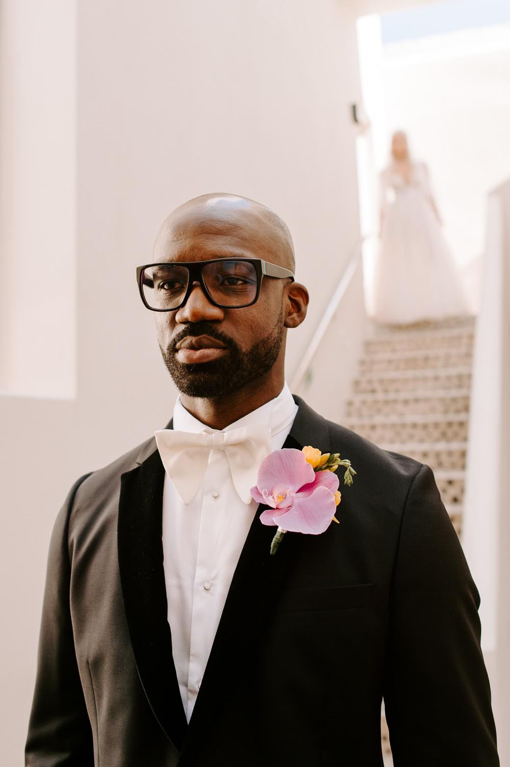 Groom Glasses Black Suit Tux Tuxedo Bow Tie Santorini Wedding Phosart Photography