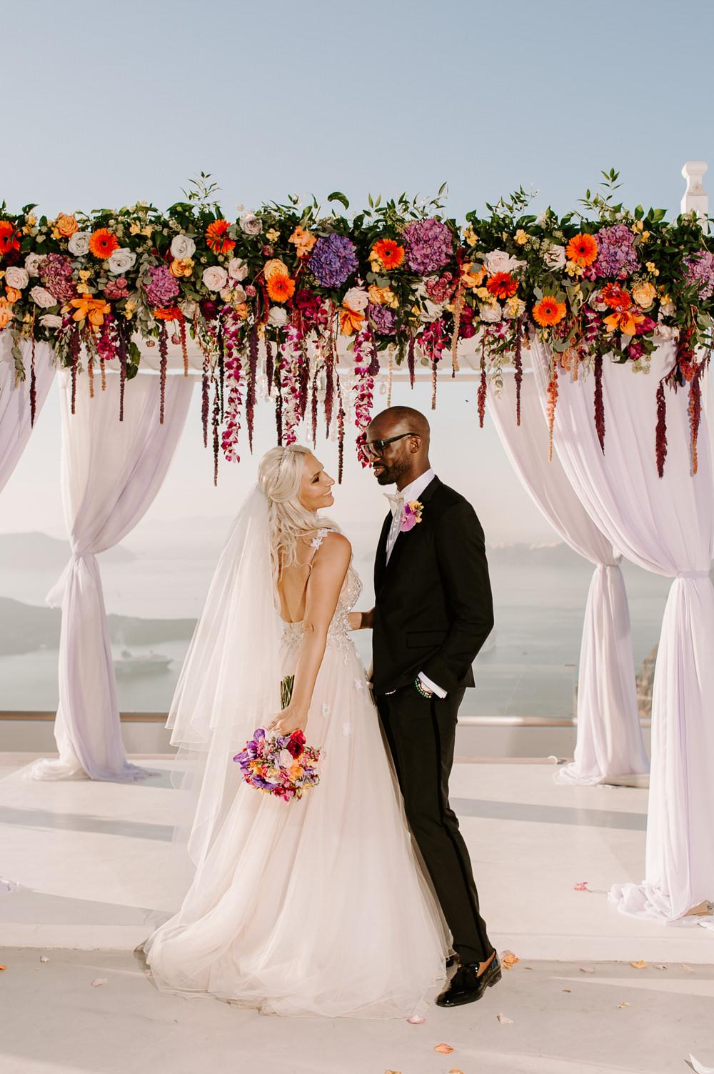 Santorini Wedding Phosart Photography Ceremony Backdrop Aisle Flower Arch Pampas Grass Rose Colourful