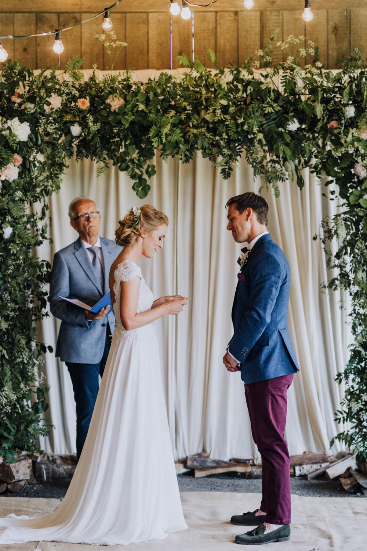 Flower Arch Backdrop Ceremony Aisle Greenery Foliage Sweden Destination Wedding Clara Cooper Photography