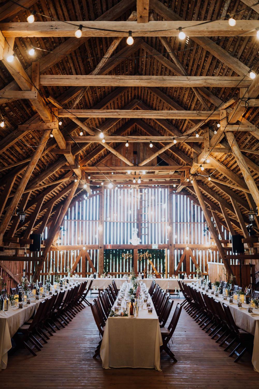 Barn Festoon Lights Long Tables Decor Reception Sweden Destination Wedding Clara Cooper Photography