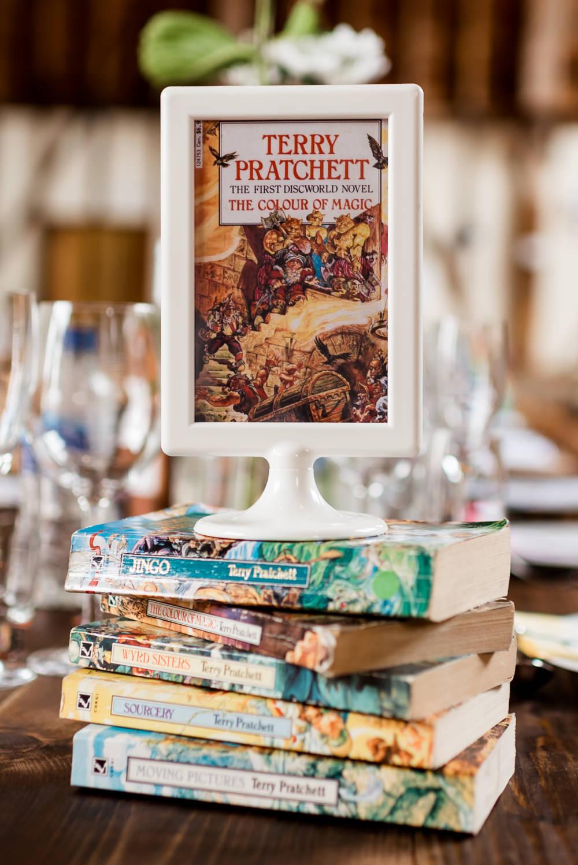 Table Name Books Centrepiece Bonhams Barn Wedding Will Patrick Photography