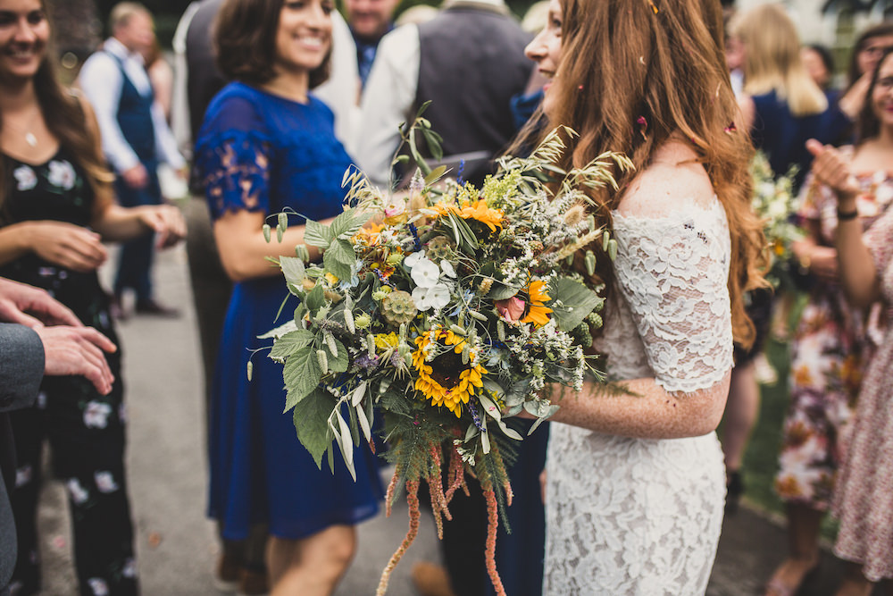 Bouquet Flowers Bride Bridal Sunflower Sundlowers Greenery Foliage Burley Manor Wedding Becky Bailey Photographer