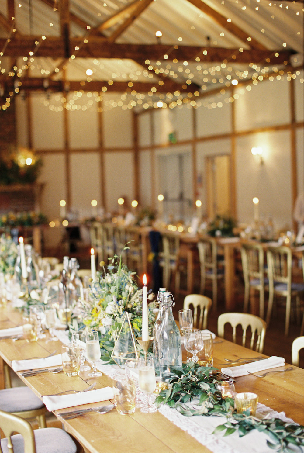 Barn Reception Fairy Lights Candles Long Tables Decor Burley Manor Wedding Becky Bailey Photographer