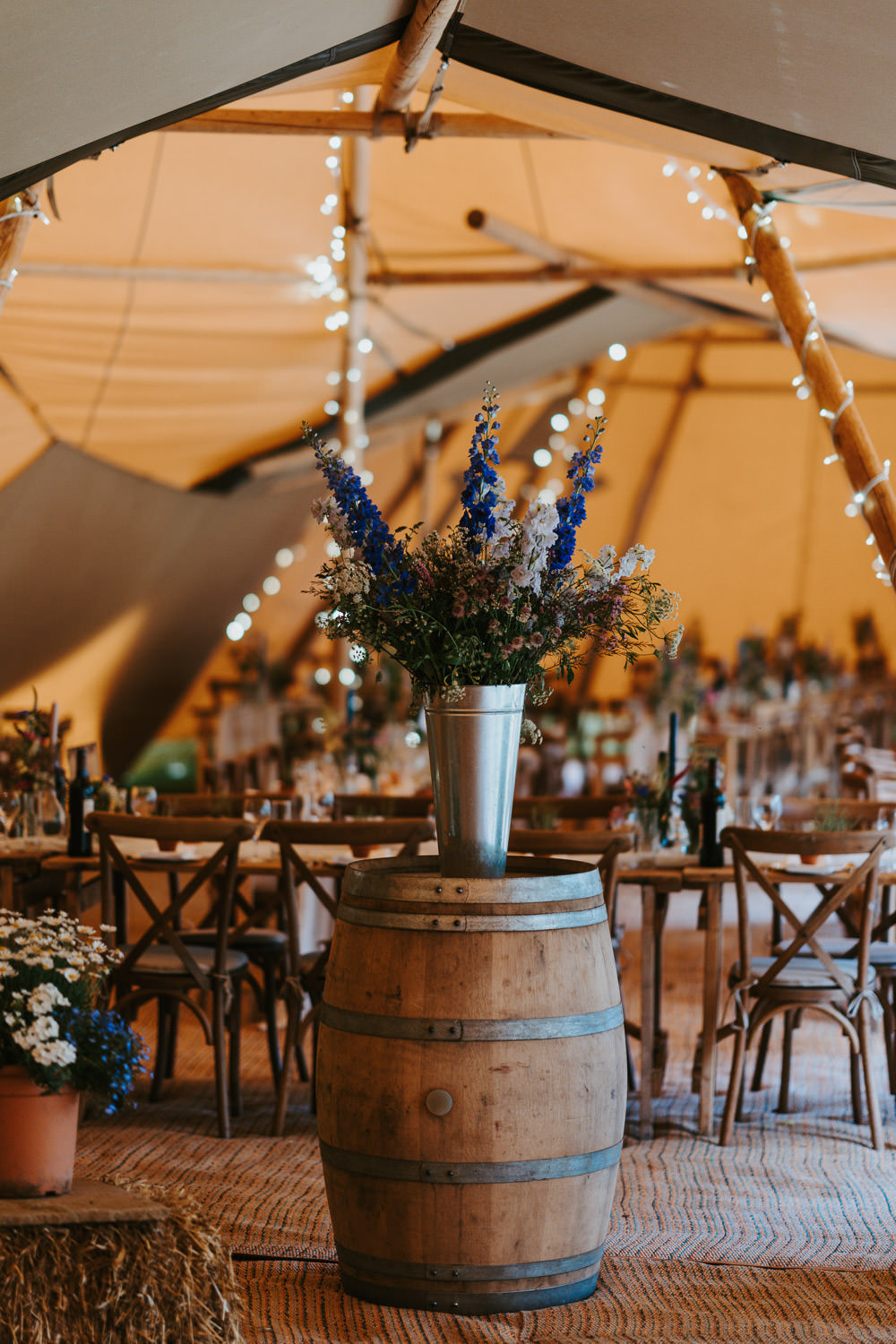 Tipi Wooden Long Tables Fairy Lights Flowers Country Festival Wedding Jonny Gouldstone Photography
