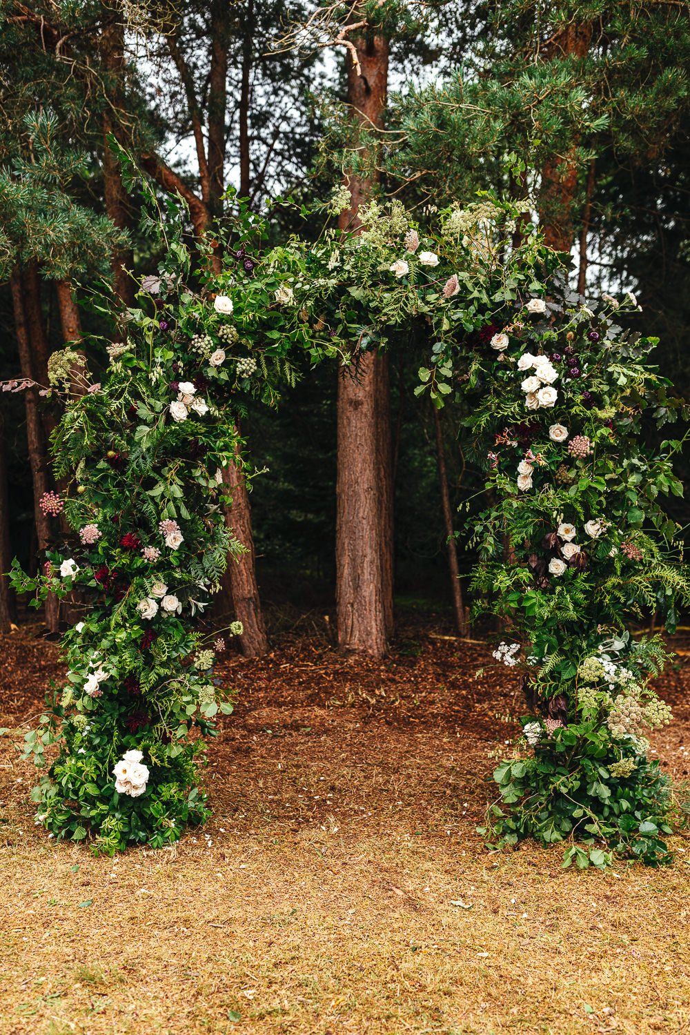 Woodland Outdoor Ceremony Flower Arch Persian Rug Aisle Greenery Foliage Festival Party Wedding Kirsty Mackenzie Photography