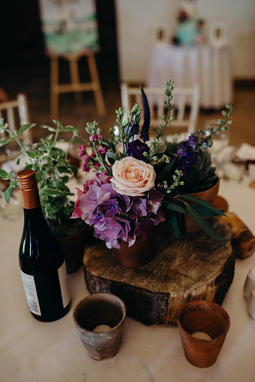 Centrepiece Decor Table Log Slice Flowers Hornington Manor Wedding Richard Skins Photography