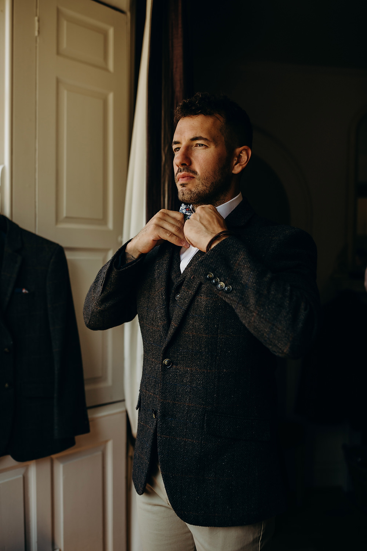 Groom Suit Tweed Jacket Waistcoat Bow Tie Trousers Hornington Manor Wedding Richard Skins Photography