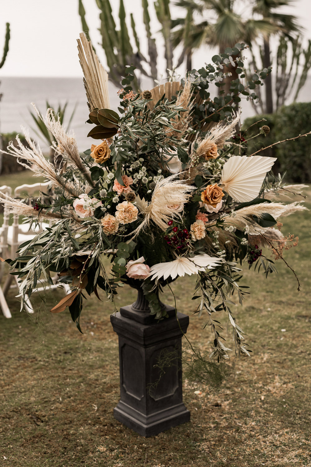 Flowers Dried Palm Leaves Greenery Foliage Orange Rose Pampas Grass Marbella Elopement Wedding Nora Photography