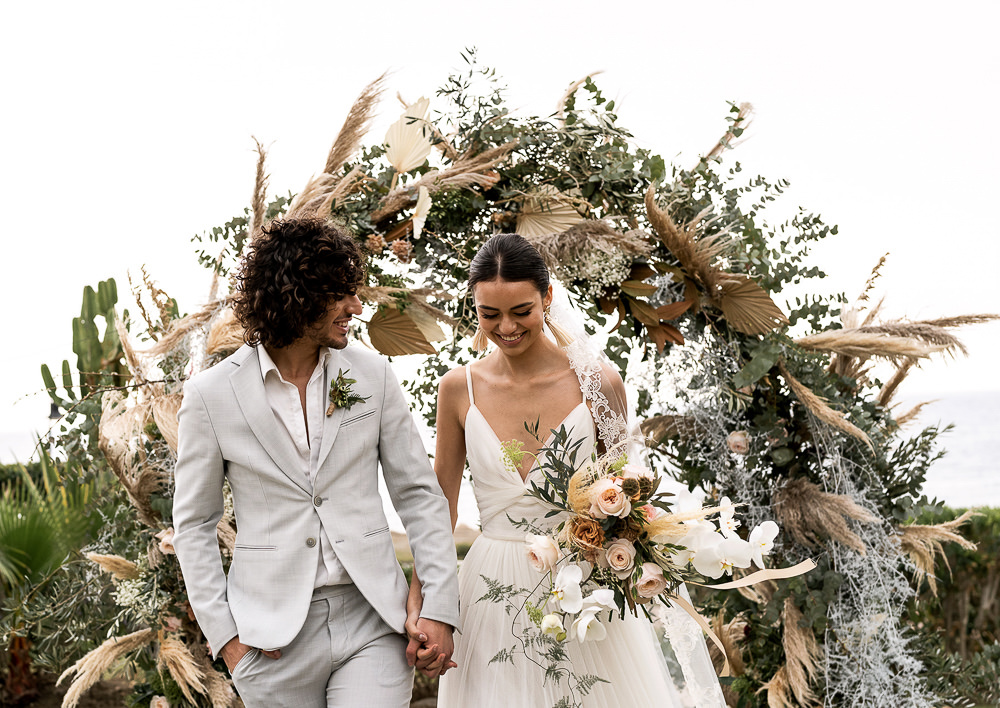 Flowers Dried Palm Leaves Greenery Foliage Orange Rose Pampas Grass Flower Arch Marbella Elopement Wedding Nora Photography