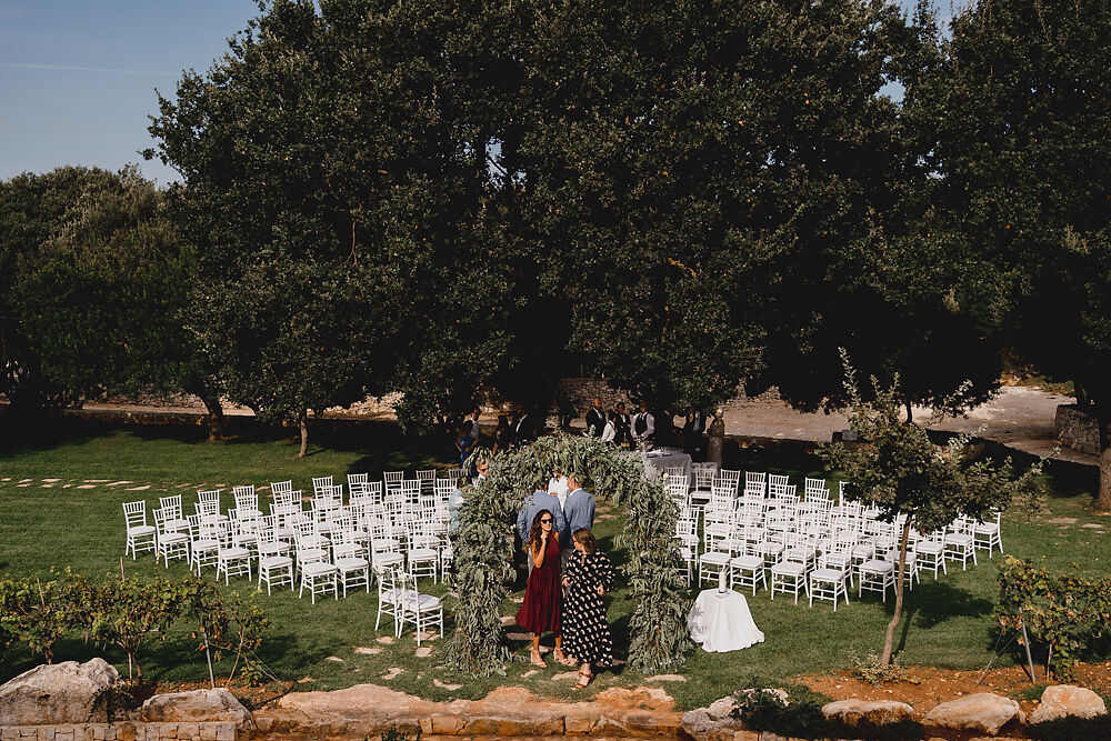 Outdoor Ceremony Flower Arch Greenery Foliage Backdrop Puglia Wedding MIKI Studios