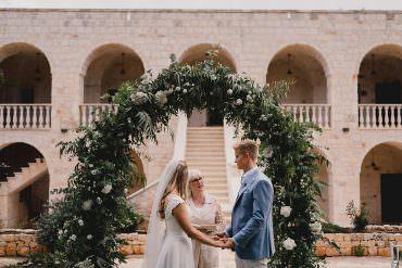 Puglia Wedding MIKI Studios Outdoor Ceremony Flower Arch Greenery Foliage Backdrop