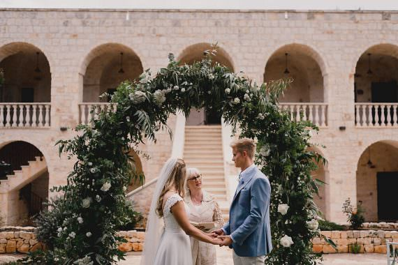 Puglia Wedding MIKI Studios Outdoor Ceremony Flower Arch Greenery Foliage Backdrop