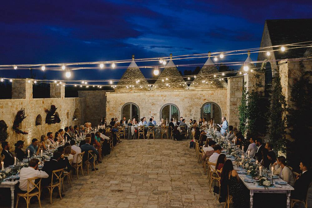 Outdoor Reception Festoon Lights U Table Greenery Foliage Candles Decor Puglia Wedding MIKI Studios