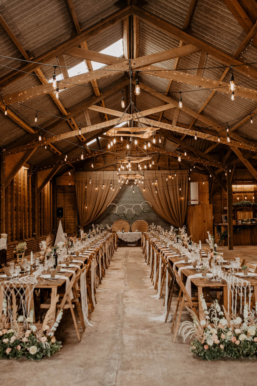 Barn Lights Lighting Flowers Long Tables Decor Whimsical Boho Wedding Camilla Andrea Photography