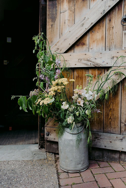 Milk Churn Flowers Entrance Belbroughton Church Hall Wedding Faye Green Photo