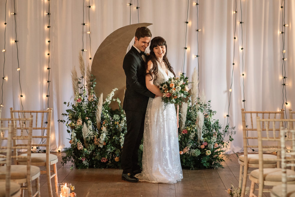 Celestial Wedding Inspiration Becky Harley Photography Moon Backdrop Crescent Fairy Lights Meadow Flowers