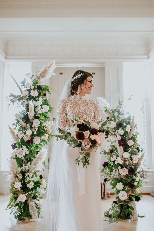 Dress Gown Bride Bridal Lace Sleeves Top Veil Lara B Bridal Chippenham Park Wedding Daniel Ackerley Photography Flower Arch Backdrop Ceremony
