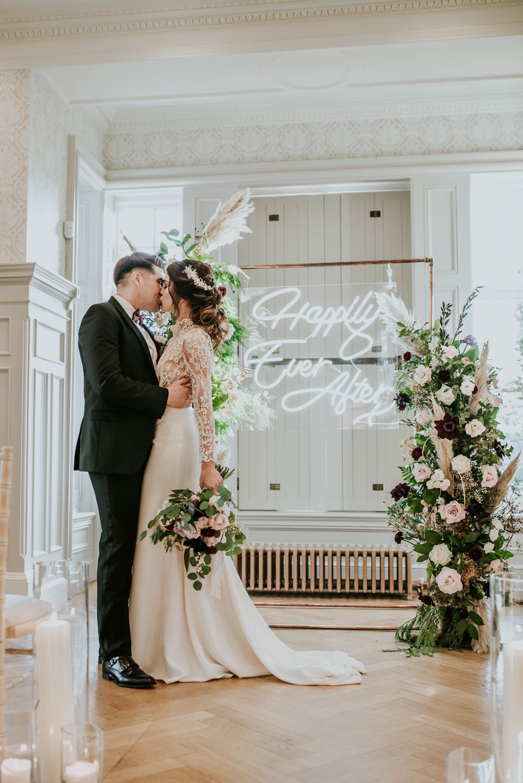 Chippenham Park Wedding Daniel Ackerley Photography Flower Arch Backdrop Ceremony Neon Sign Light