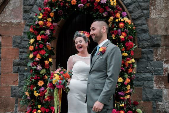 Glenarm Castle Wedding Jonathan Ryder Photography Flower Arch Church Ceremony Colourful