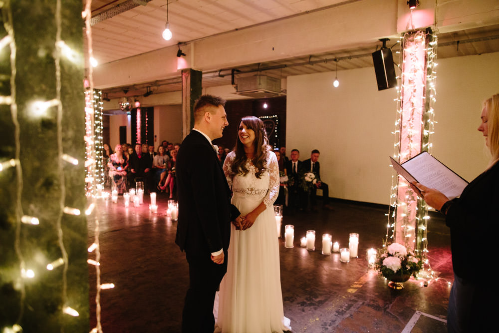 Fairy Lights Lighting Candles Ceremony Indie Warehouse Wedding Dan Hough Photo