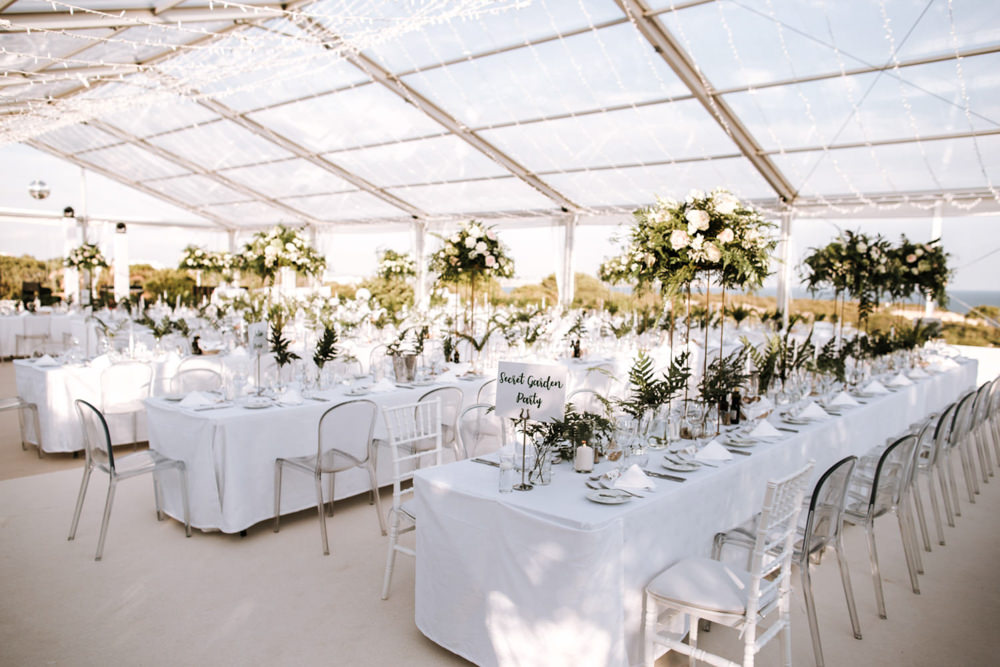 Clear Marquee Decor Long Tables Greenery Foliage Ghost Chairs Portugal Destination Wedding The Lovers Imagery